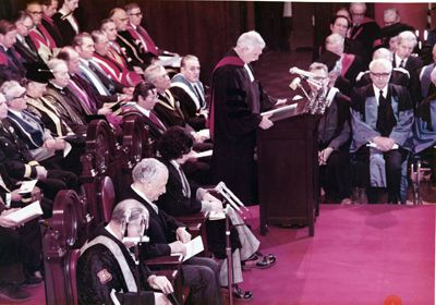 Laverty addresses Queen's graduates at the 1970 Convocation ceremony in Grant Hall.