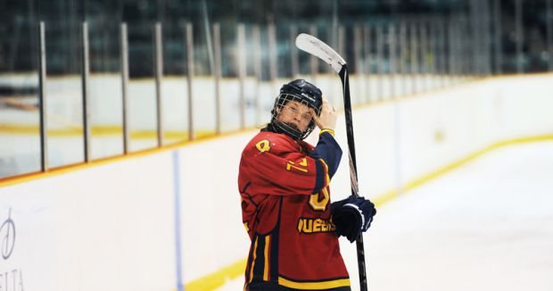 Forward Kelsey Thomson rests during a break in the bronze-medal game.