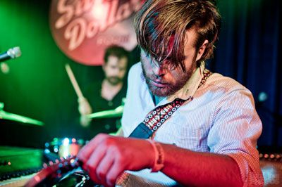 "After Jason Couse (foreground) stepped up to front the new incarnation of The Darcys, the band turned on the internal pressure to focus fully on releasing new material. Drummer Wes Maskrell (background) cited the band's mantra for writing as, ""it better be fucking good."""