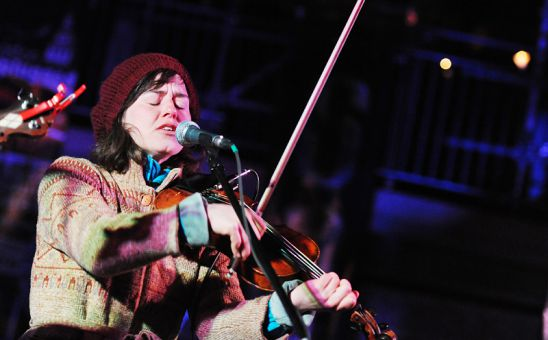 Amanda Balsys, one of the many members of local group The Gertrudes, plays a completely solar and wind-powered set in Market Square on Saturday to commemorate Earth Hour, an effort established in 2007 in Sydney to raise awareness around climate change.