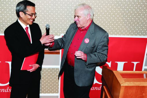 Kingston and the Islands MP Ted Hsu (left) and the riding's former MP, Liberal Peter Milliken, at Hsu's election party on May 2.