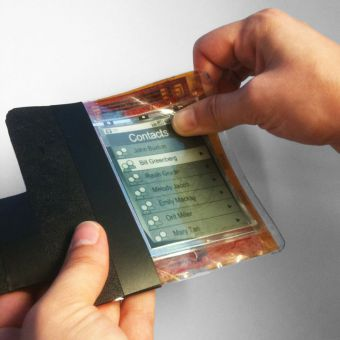 Users of the flexible smartphone can bend corners to perform different actions like playing music, taking notes and making phone calls. The phone could be on the market within 10 years.