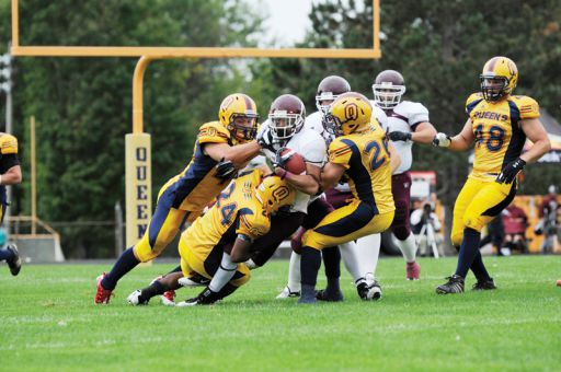 Gaels defenders swarm a McMaster player.