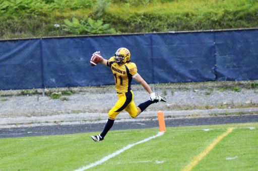 Giovanni Aprile scores one of his four touchdowns against Laurier on Saturday.