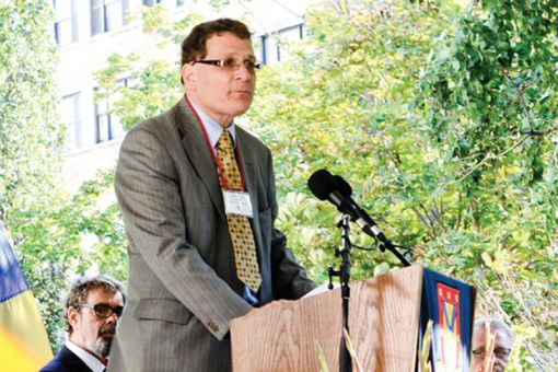 Principal Daniel Woolf speaks to the crowd at the new medical building's grand opening on Sept. 22.