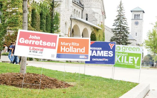 Local candidate lawn signs on display outside Ontario Hall on Queen's Campus