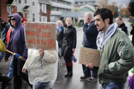 Queen's exchange student Antonio Cillero of Spain was one of approximately 20 protesters who marched on Princess Street on Saturday as part of the Occupy Kingston movement.