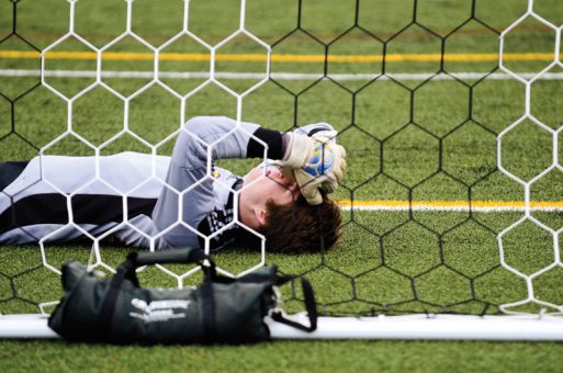 Goalkeeper Dylan Maxwell holds his head after the Gaels' shootout loss to the Laurentian Voyageurs in an OUA playoff game on Wednesday.