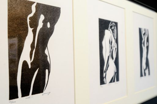 Larry Thompson's black and white prints show a variety of themes, including nude portraits and furniture stills.