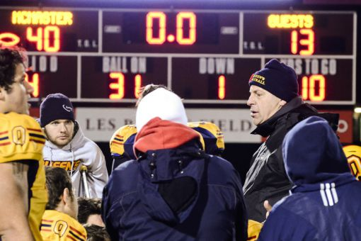 Head coach Pat Sheahan (back right) talks to his team after Saturday's loss. In nine seasons, Sheahan's playoff record is 10-8.