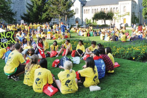 Queen's students gather into themed groups during Frosh Week.