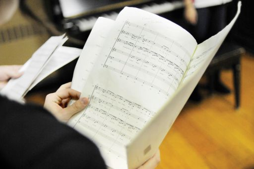 Reading music makes the a cappella rehearsal process easier, says Momentum musical director Dan Boyle.