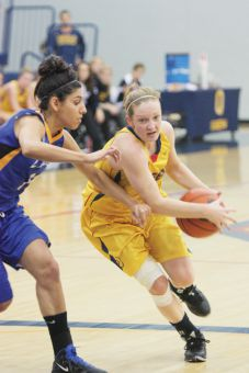 Guaurd Brittany Moore scored 13 of her team's 17 points in overtime against the Guelph Gryphons on Saturday.