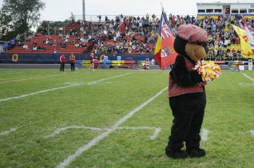 BooHoo the Bear is the Queen's Bands mascot.