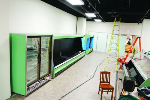 A grocery store and pharmacy began construction in the vacant Queen's Centre space in January.