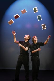 Juggling cigar boxes involves jugglers exchanging several wooden boxes.