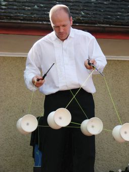 Diabolo is a spool designed to spin on a string, attached to two sticks.