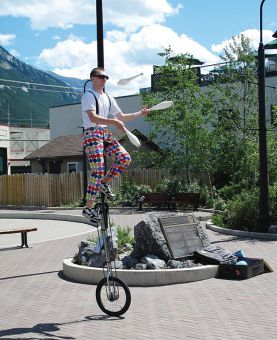 Alex Perren juggles on a unicycle in Banff, Alta.