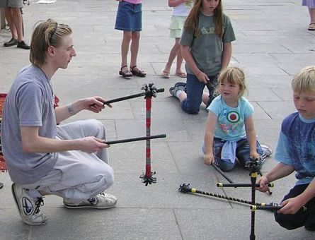The manipulation of devil sticks — the baton controlled and thrown by two control sticks — is a form of juggling.