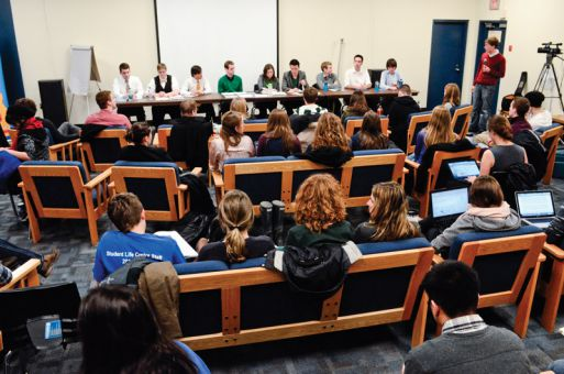 AMS executive candidates participate in the vice-president of university affairs debate on Monday night as part of their campaigning.
