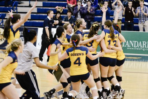 The women's volleyball team celebrates a five-set win over the Ottawa Gee-Gees at the ARC on Friday night.