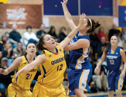 Post Sydney Kernahan goes up to block a shot against the Ryerson Rams.