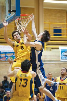 Forward Alex Weatherill defends the basket.