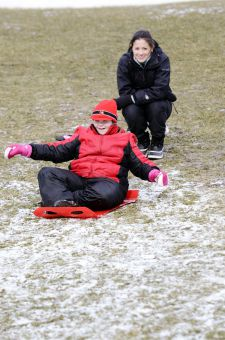 Lenna Sonneveld (left) and Paula Wong, PheKin '12, (right) participate in the Winter Adaptive Games.