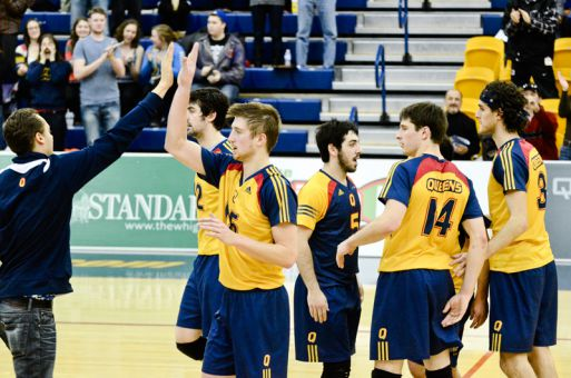 The men's volleyball team celebrates after a 3-0 win over the Windsor Lancers at the ARC on Sunday.