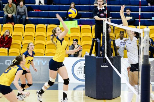 Outside hitter Katie Neville jumps to spike the ball against the Windsor Lancers on Sunday.