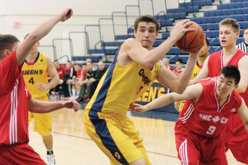 Gaels centre John Lenz brings down a rebound against the Royal Military College Paladins on Saturday night.