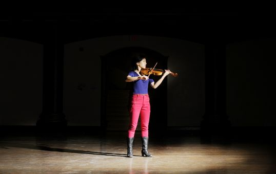 Deanna Choi, ArtSci '14, practices in Grant Hall Wednesday night. Choi won the 2011 gold medal for violin, granted by the Royal Conservatory of Music.