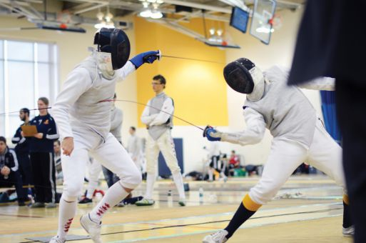 Gaels foil fencer Matt Kaiser (right) goes against the Royal Military College in the bout for men's team foil bronze at the OUA championships this weekend held at the ARC.