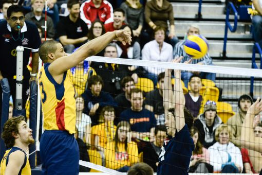 Middle hitter Mike Amoroso spikes against the Trinity Western Spartans on March 3 at the ARC.