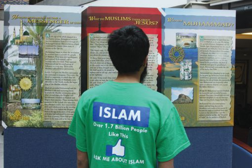Mohaimen Hyder, ArtSci '15, stands in front of one of the displays set up by the Queen's University Muslim Student Association in the JDUC. The display discusses the history of Islam.