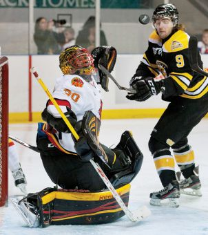 Forward Cody Alcock (left) and the Kingston Frontenacs are last place in the Ontario Hockey League's Eastern Conference.