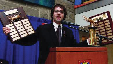 Former AMS President Ethan Rabidoux awarded Phil Lam the Golden Cockroach in 2006.