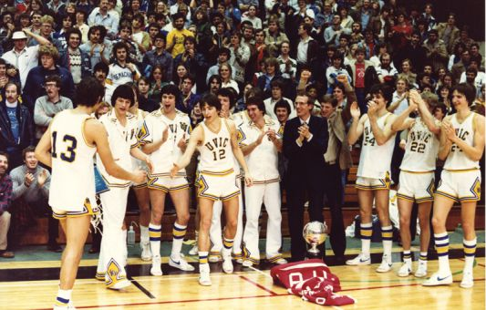Head coach Ken Shields, centre, celebrates one of seven CIS titles with the University of Victoria Vikes. He wants CIS basketball to return to the competitive standard that his Vikes team set from 1976 to 1989.