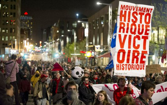 Quebec students march in protest against a provincial plan to increase their tuition by $1,625 over the next five years.