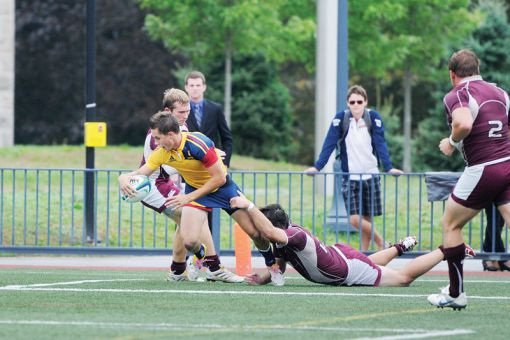 Liam Underwood fights off a tackle to score a try against McMaster on Nov. 5, 2011.