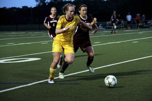 Ottawa native Laura Callender challenges for the ball against a Gee-Gees opponent.
