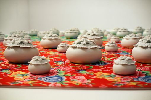 Flower Series #1 features ceramic flowers atop a floral-patterned backdrop.