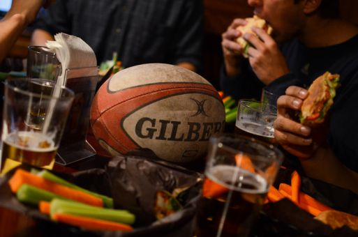 After a hard-fought game, visiting rugby teams are treated to a meal by their hosts.