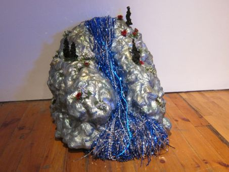 The island structures in Samantha Mogelonsky's exhibit are made out of silver painted plaster.