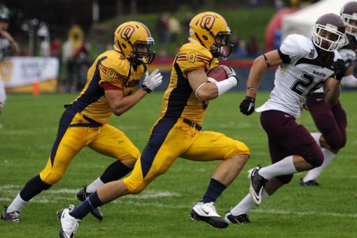 According to Marty Clark, PhD '12, the reason the community gravitates towards football is that it represents traits we value most in society, like teamwork.