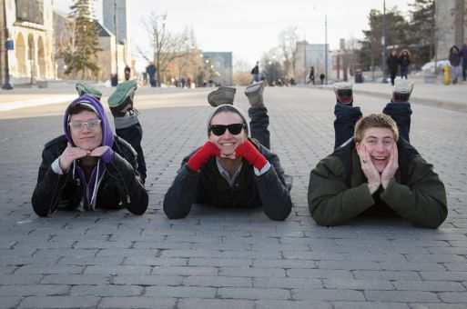 The three members of Turkey Turkey (from left to right: Riley Shaw, Tom Yeates and David Cronin) pose in the middle of University Ave. after coming up with the concept for this photo on their own.