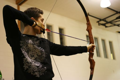 Archers, like Chris Ormrod, ArtSci '14, gather three times a week to shoot arrows in the Duncan McArthur Hall gymnasium on West Campus.