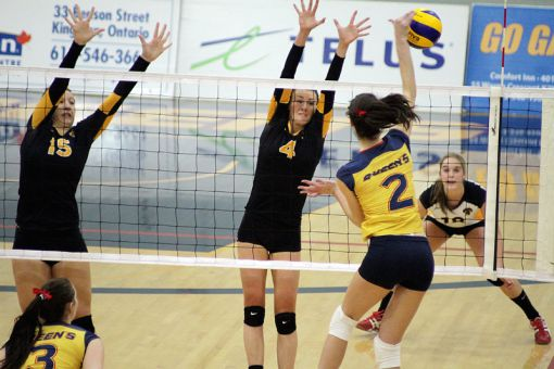 Gaels' third year right side hitter Kelsey Bishop spikes the ball in Sunday's game against Waterloo.