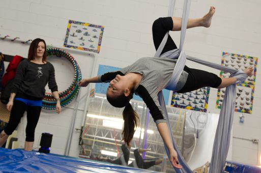 Erin Ball watches on as I attempt a move on the aerial silk (described in factbox).