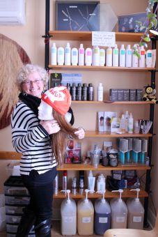 Beata Faraklas, hair specialist and owner at All Hair Alternatives, spends time consulting each client on their wig of choice.
